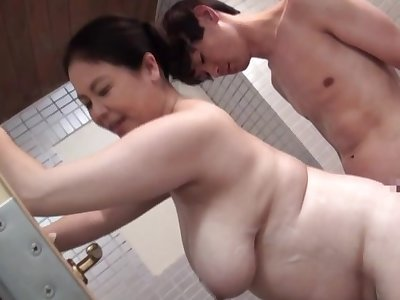 Broad in the beam Japan mom bends depart from for a young cock