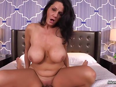 Experienced brunette with reference to massive milk jugs is riding a rock firm cock, free of any charge