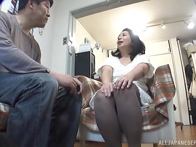 Amateur Asian wife Sawaki Erika gets undressed and fucked from behind