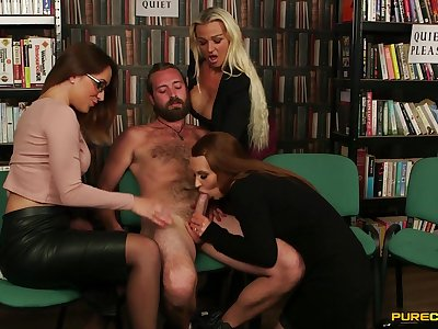 Three horny babes team up to suck a dick of a handful of fortuitous dude